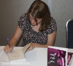 Roni Loren busy signing copies of her latest book.